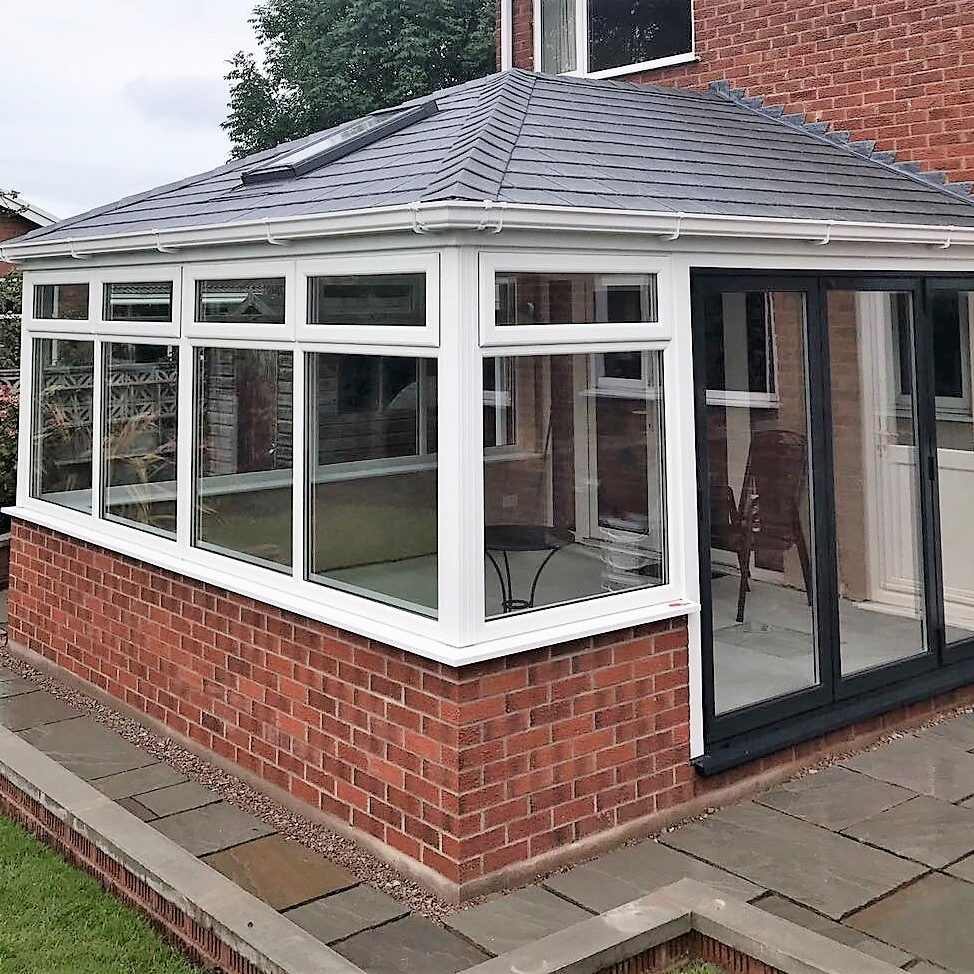 Tiled conservatory roof and bifold doors from Trade Frames